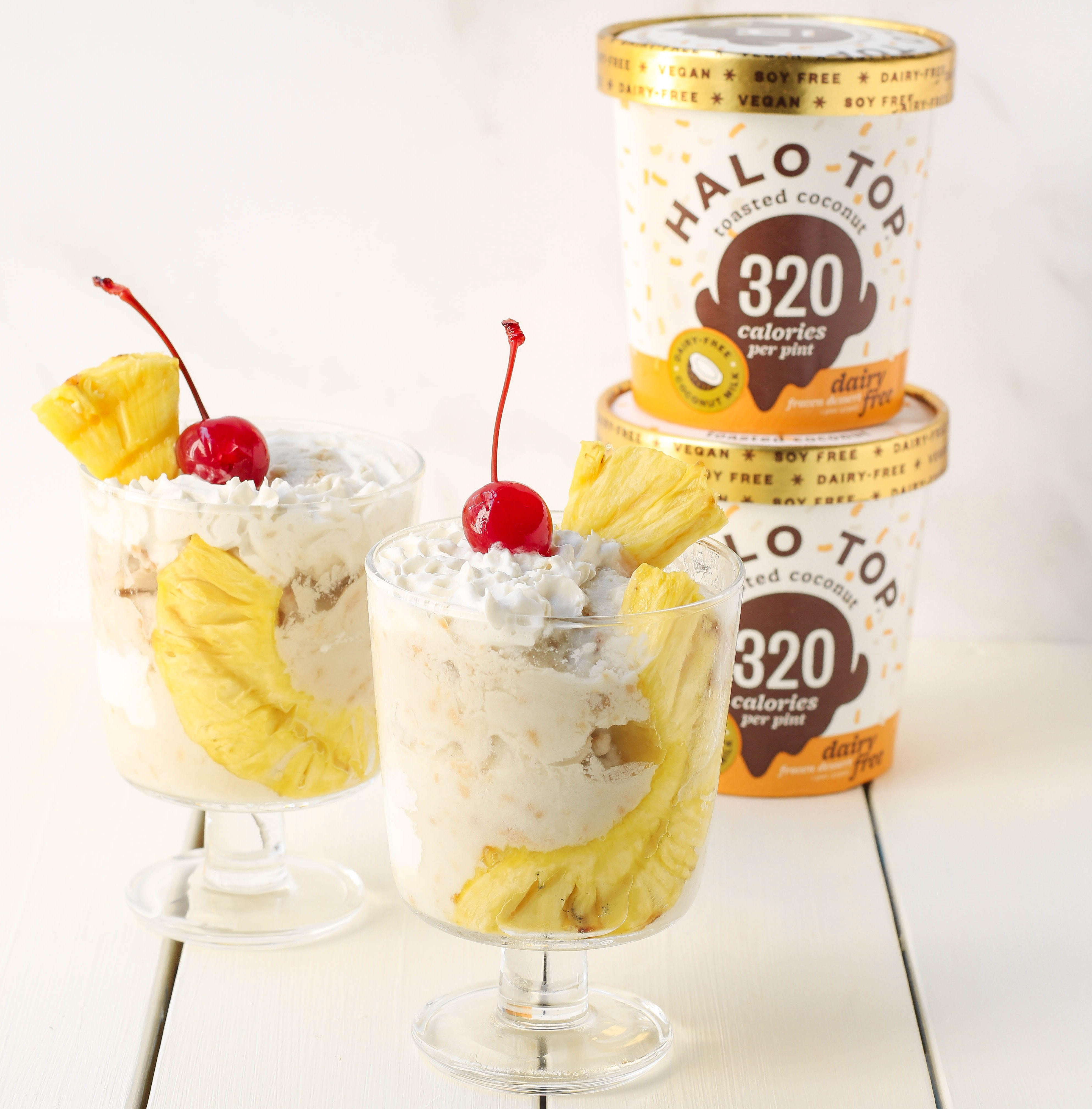 Pina Colada Sundae Cups with two Toasted Coconut Halo Top pints stacked